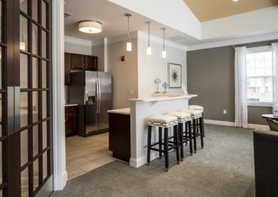 coffee station and kitchen in the resident lounge at Jacksonville Station's Warminster apartments