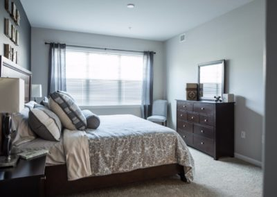 bedroom with large windows in a Warminster apartment at Jacksonville Station